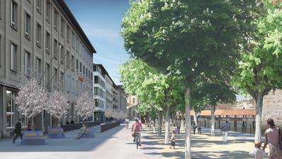 So soll die umgestaltete Bahnhofstrasse dereinst aussehen. Links die Einfahrt in die unterirdische Velostation. (Visualisierung: PD/Stadt Luzern)