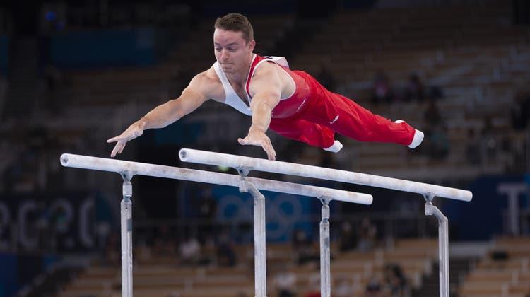 Christian Baumann geht an der WM in Japan nur am Barren an den Start. Das Ziel: Qualifikation für den Geräte-Final. (Keystone)