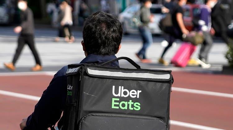 Durch Pandemie verstärkt: Essenlieferanten wie Uber Eats haben neuen Schwung erhalten. (Symbolbild) (Keystone)