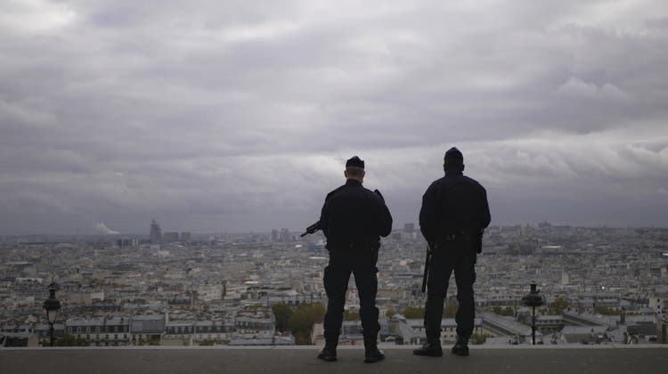 FILE - In this Oct. 30, 2020, file photo, police officers stand guard next to the Sacre Coeur basilica in Paris, following an attack at a church in the Mediterranean city of Nice. Scrubbing France clean of radicals and their breeding grounds is a priority cause of President Emmanuel Macron in a nation bloodied by terror attacks, including the beheading of a teacher outside his school in a Paris suburb followed by a deadly attack inside the basilica in Nice. (AP Photo/Thibault Camus) (Thibault Camus / AP)