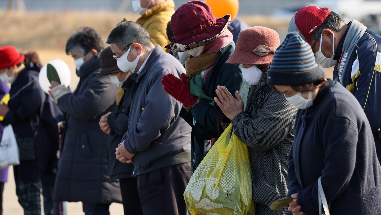 Menschen in Japan gedenken den Opfern der Nuklear-Katastrophe in Fukushima vor zehn Jahren. (Keystone)