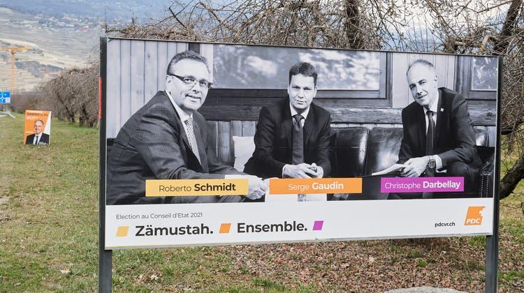«Zämustah»: Wahlplakat für das Dreierticket der C-Parteien. (Olivier Maire / KEYSTONE)