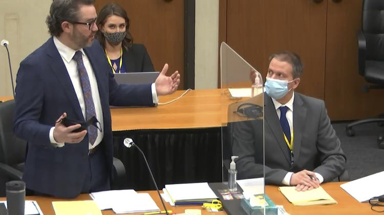 In this image from video, defense attorney Eric Nelson, left, discusses motions before the court as defendant, former Minneapolis police officer Derek Chauvin, right, and Nelson's assistant Amy Voss, back, listen, Monday, April 12, 2021, as Hennepin County Judge PeterCahill presides over the trial of Chauvin at the Hennepin County Courthouse in Minneapolis. Chauvin is charged in the May 25, 2020 death of George Floyd. (Court TV, via AP, Pool) (AP)