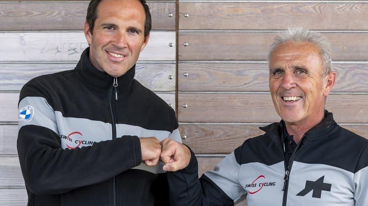 Michael Albasini (links) ist Nachfolger seines Vater Marcello als Nationaltrainer. (Bild: Jean-Christophe Bott/Keystone)