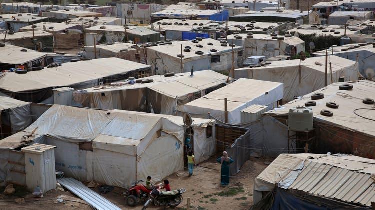 Beispiel Libanon: In diesem Flüchtlingslager des UNHCR leben viele geflüchtete Menschen aus Syrien. (Archivbild) (Keystone)