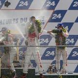 2010 gewann Mike Rockenfeller (Bildmitte) das prestigeträchtige 24-Stundenrennen von Le Mans. (Bild: DPA)