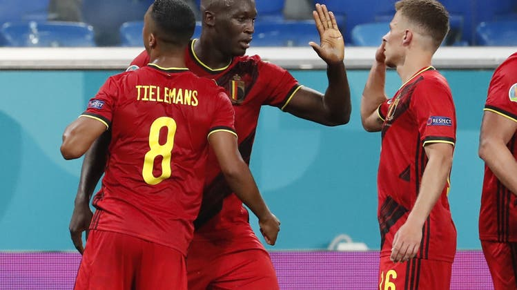 Belgium's Romelu Lukaku, center, celebrates with teammates after scoring his side's 3rd goal during the Euro 2020 soccer championship group B match between Belgium and Russia at the Saint Petersburg stadium in St. Petersburg, Russia, Saturday, June 12, 2021. (Anatoly Maltsev/Pool via AP) (Anatoly Maltsev / AP)