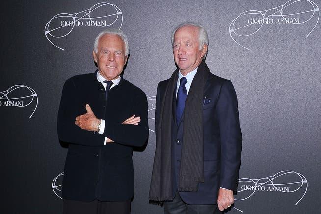 Proficua collaborazione: il fondatore di Luxottica Leonardo del Vecchio (a destra) con il designer Giorgio Armani.
