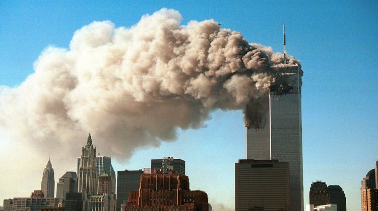 394261 11: Smoke pours from the World Trade Center after it was hit by two hijacjked passenger planes September 11, 2001 in New York City in an alleged terrorist attack. (Photo by Robert Giroux/Getty Images) (Robert Giroux / Getty Images North America)