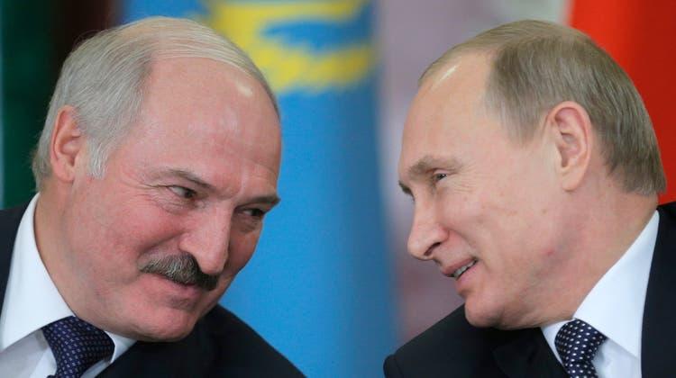 Lukaschenko und Putin im Jahr 2014. (Keystone)